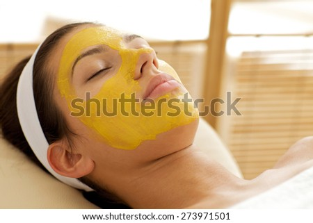 Close-up of young woman wearing facial mask - stock photo