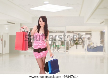 Close-up of young woman whith shopping bags  in the shopping mall