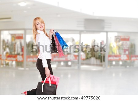 Close-up of young woman with shopping bags  in the shopping mall - stock photo