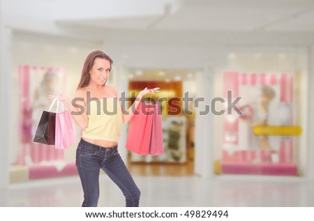 Close-up of young woman with shopping bags  in the shopping mall