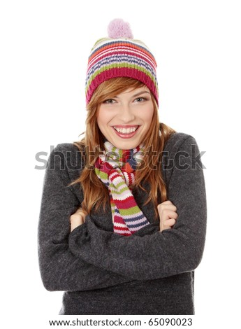 Close up of young woman with winter cap smiling at the camera isoalated on white background - stock photo