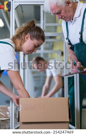 Close-up of young working woman in warehouse - stock photo