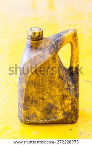 Close up old and dirty car engine oil gallon, plastic container, automotive maintenance service - stock photo