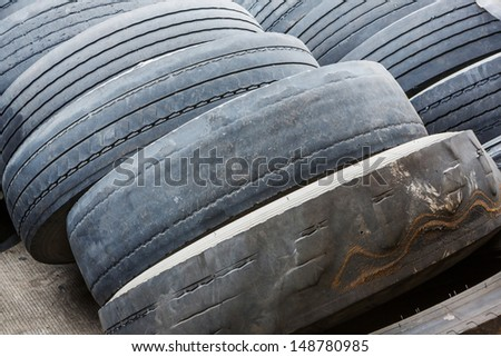 Close up old and ruin no tread on tires in car garage - stock photo