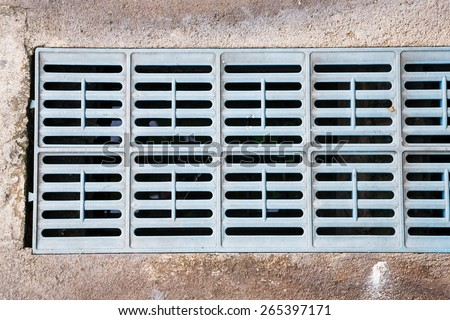 Close up old and weathered plastic trench drain grates in city - stock photo