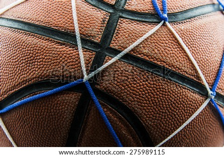 Close up old basketball ball in a net. - stock photo