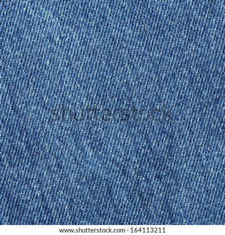 Close up old blue jean or denim cloth texture background - stock photo