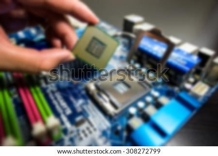 Close up old CPU Processor socket with mainboard blurry background - stock photo