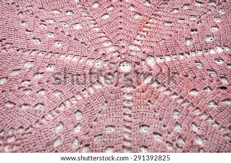 Close up old handmade crochet colored doily  - stock photo