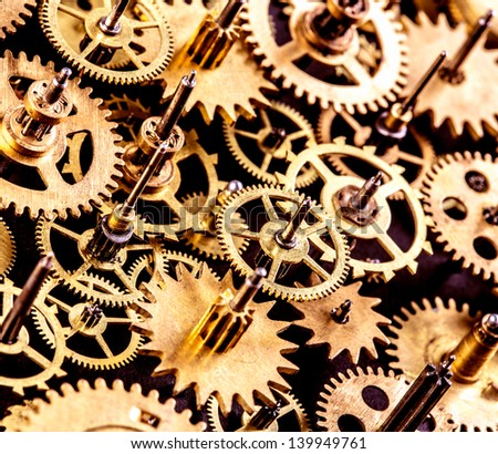 close up old mechanism on a black background - stock photo