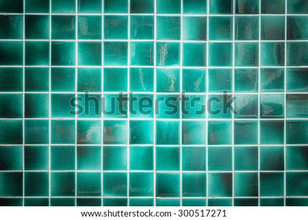 Close up old pattern green ceramic bathroom wall tile texture and background - stock photo