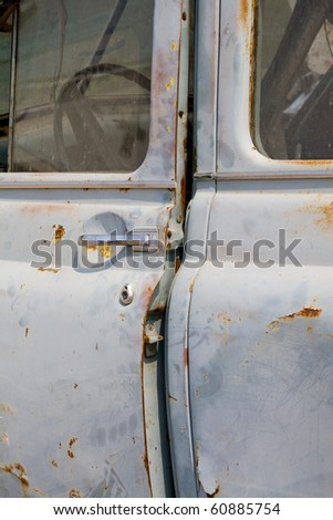 Close up old rusty abandoned car - stock photo