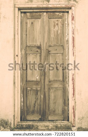 Close Up Old Vintage Rustic Wooden Door On Cement Wall Background