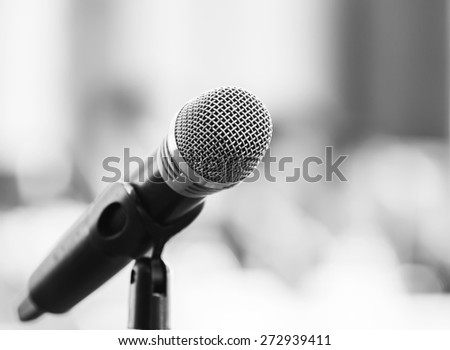 Close up old wireless microphone in conference room, meeting, seminar - stock photo