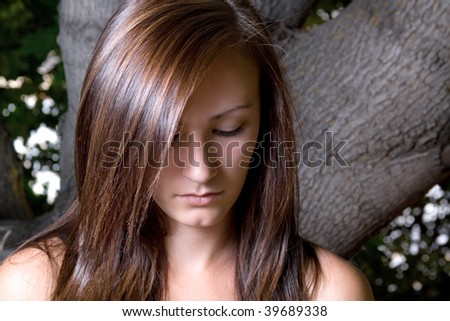 Close up on a Beautiful Depressed Teenager Posing - stock photo