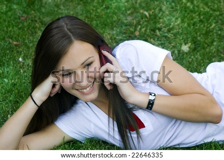 Close up on a Beautiful Girl Talking on a Cell Phone - stock photo