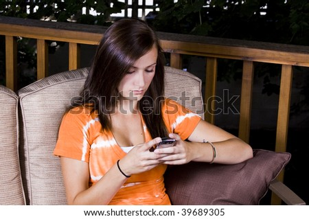 Close up on a Beautiful Girl Texting Outside - stock photo