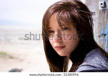 Close up on a Beautiful Teenager Sitting on an Old Abandoned Train - stock photo