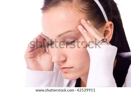 Close up on a Beautiful Teenager with a Headache Rubbing her Temples - stock photo
