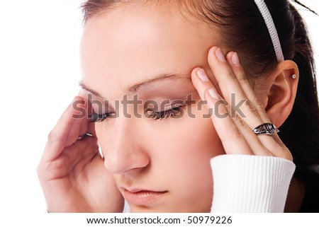 Close up on a Beautiful Woman with a Headache Rubbing her Temples - stock photo