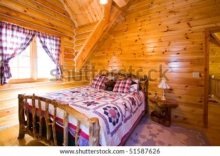 Close up on a Bedroom in a Log Cabin - stock photo