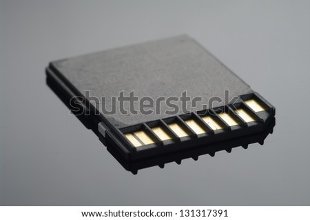 Close up on a black SD memory cards arranged over black - stock photo