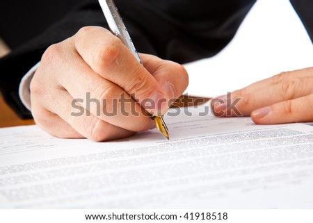Close up on a businessman hands signing a contract. Isolated on white background - stock photo