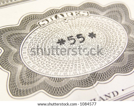 Close-up on a capital stock shares certificate in grey. New York Stock Exchange, Wall Street. - stock photo
