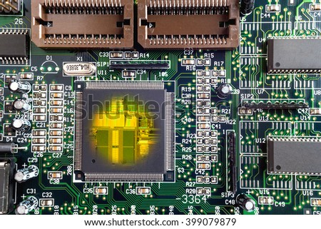 Close-up on a CPU microchip on a scheme in mainboard is heart important computer or electronic circuits. Silicone crystall. - stock photo