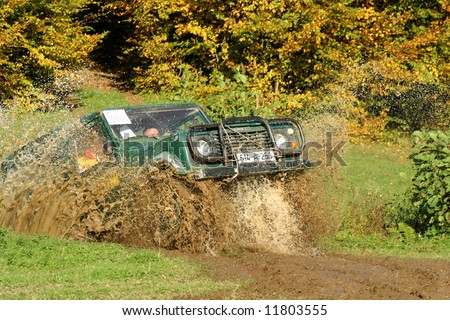 Close-up on a front end of  all-terrain vehicle participating in off-road challenge - stock photo