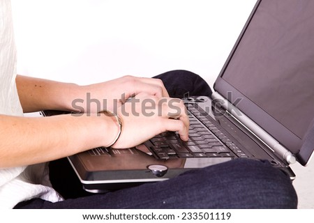 Close up on a Girl's Hand Typing on the Laptop - stock photo