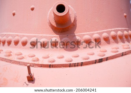 Close up on a iron part of an old steam locomotive - stock photo