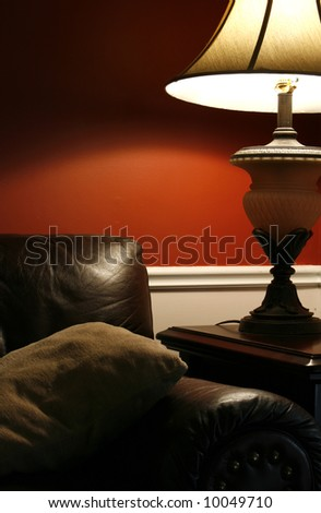 Close up on a Lamp and the Coush in a House - stock photo