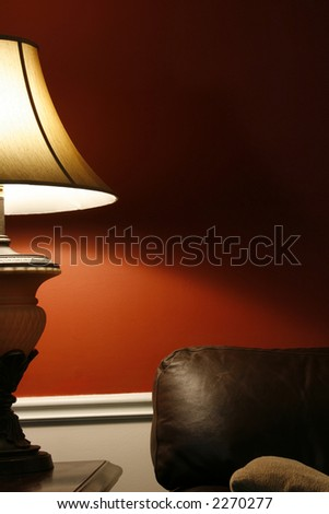 Close up on a Lamp and the Coush in a House - Vertical Shot
