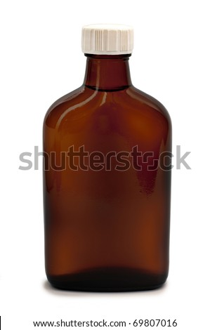 Close up on a medicine bottle isolated on white