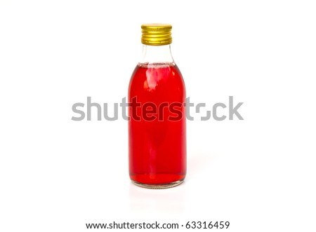 Close up on a medicine bottle with red syrup isolated on a white background. - stock photo