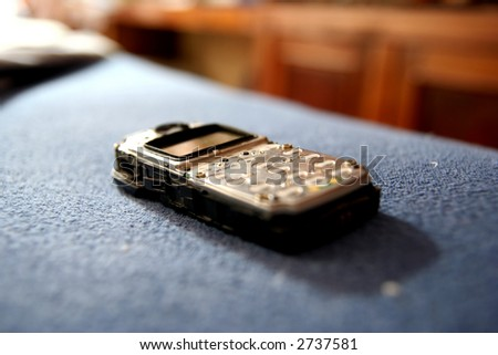 Close up on a mobile phone with blur background