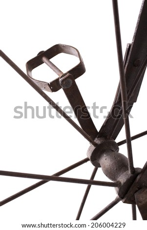 Close up on a pedal of historical bicycle - stock photo