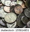 Close up on a pile of American coins US money with main focus on one Dollar coin - stock