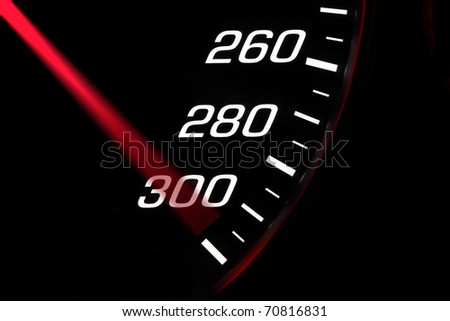 Close up on a speedometer reaching maximum speed - stock photo