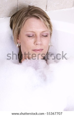Close up on a Woman in the Tub Bathing