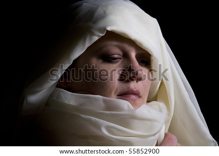 Close up on a Woman in Veil - Black Background