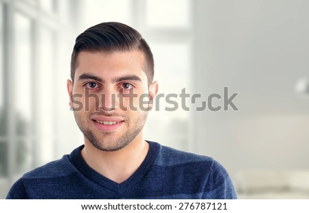 Close-up on a young business man in a modern office - stock photo