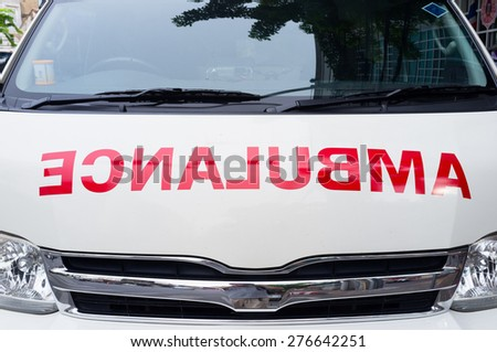 Close up on ambulance van front side - flipped - stock photo
