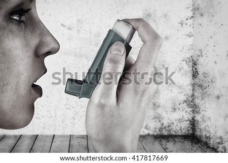 Close up on an asthmatic woman against image of a room corner - stock photo