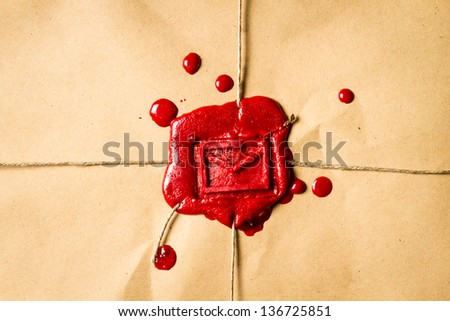 Close-up on an envelope with red sealing wax - stock photo