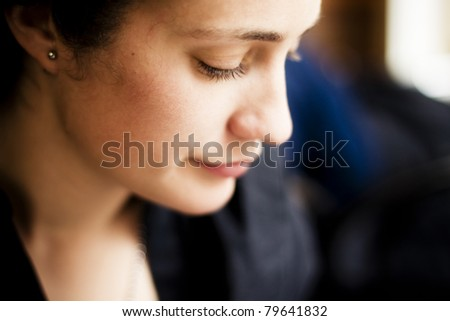 Close up on beautiful woman profile. - stock photo