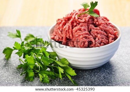 Close up on bowl of lean red raw ground meat - stock photo