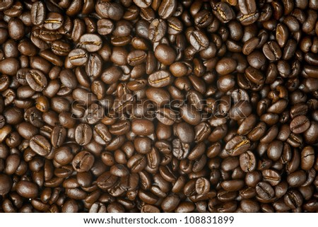 Close up on brown coffee bean background texture - stock photo