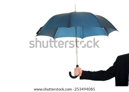 Close up on businessman hand with an umbrella.